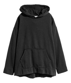 Black. Oversized, wide-cut sweatshirt fabric with a lined hood and ribbed hem. Dropped shoulders, kangaroo pocket at front, and long, wide sleeves with