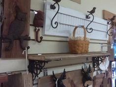 Repurposed shutter, barn wood shelf, & rustic hooks on barn wood.