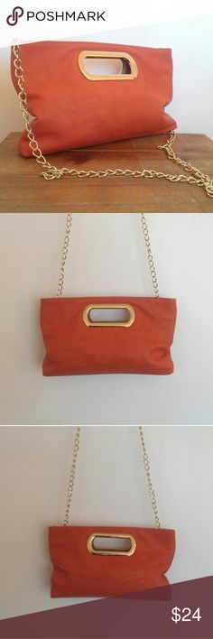 Charming Charlie Orange Faux Leather Purse Nice bag from Charming Charlie. Orange faux leather with goldtone handle and hidden chain strap. Patterned beige lining with double magnet closure and one interior zip pocket. Near new condition with just one tiny chip on the bottom left edge (last pic).  Height: 8.75 inches Length: 11.5 inches Depth: 1.5 inches Strap drop: 24 inches  Free gift wrapping on request. Charming Charlie Bags Crossbody Bags
