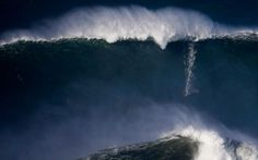A surfer rode a huge wave at Praia do Norte, in Nazaré, Portugal. The beach has been drawing big wave surfers since the Hawaiian surfer Garrett McNamara broke a world record for the largest wave surfed here in 2011. Rafael Marchante/Reuters