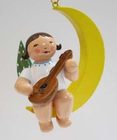 """From the Wendt and Kühn classic Angel ornament collection - An Angel Sitting on the Moon with a Mandolin. 2"""". Made in Germany.  Available at www.mygrowingtraditions.com"""