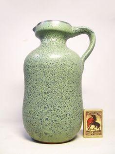 "SIEGFRIED GRAMANN | EAST GERMAN ART POTTERY   Siegfried Gramann- Römhild ceramic vase ca. 1960's.  Nice pitcher vase with green lava glazing. Blue interior glazing. Impressed mark ""TR"" on the base.    Dim. ca.: height 21cm, weight 780g"