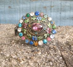 Hey, I found this really awesome Etsy listing at https://www.etsy.com/listing/91715473/vintage-brooch-multi-colored-gems-little
