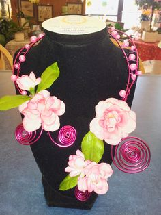 Try something different this year with a flower necklace made of pink wound wire, pearl beads, and silk of fresh flowers! Original design by The Laurel Wreath LLC in Franklin, WI. #prom #promflowers #flowernecklace