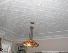 This ceiling uses the Camellia pressed tin panels in the central area, surrounded by moulding strips and a border made from the Stockholm design. The cornice is the Celtic design. Learn more about the Camellia panels here: http://www.heritageceilings.com.au/tempat/camellia.php