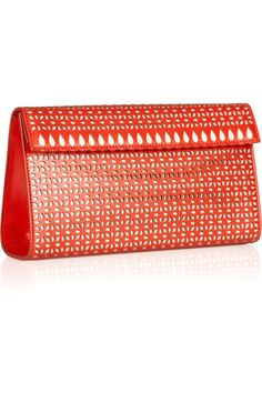 ALAÏA  Laser-cut leather clutch  $1,805
