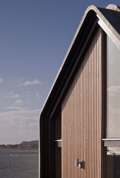 WT Architecture, Elie House Curved zinc, larch cladding