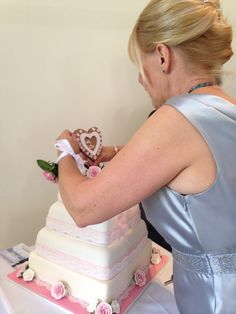 Mam puts the finishing touches to her sons cake x