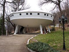 "UFO house in Chattanooga, TennesseeOuter space is the theme for this otherworldly house, which ""landed"" in 1970. Built by a man who likes unusual things, the Frisbee-shaped space-age wonder sits on steel legs and is encircled by square windows. Inside, three bedrooms and two baths make the homeowners comfortable. And when they want privacy, all they have to do is press a button to retract the staircase."