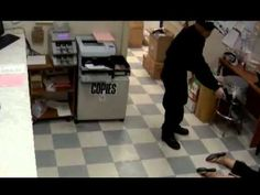 """Surveillance video released in robbery of $87K from Fishtown food distributor (1/2) Two assailants knocked on the door of Kawa Trading Corp. on the 1700 block of North Delaware Avenue shortly after 2 a.m. Wednesday and identified themselves as police. When the owners of the business opened the door, the attackers -- who were wearing hats emblazoned with the word """"police"""" -- forced their way inside. One of them was wearing a badge."""