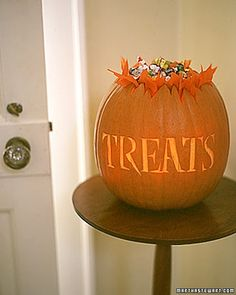 Get double duty out of your jack-o'-lantern by using it as a glowing candy bowl.