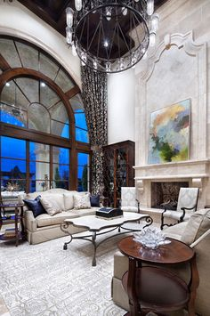Grand living room, beautiful fireplace with large artwork. Amazing window!