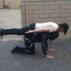 Ronnie Radke planking on Andy biersack