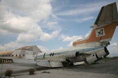 An abandoned Cyprus Airways plane lies on the tarmac at the decaying Nicosia International Airport.