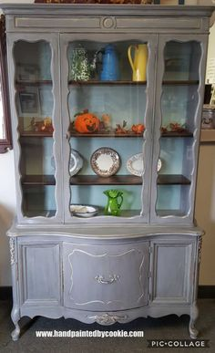 #vintage #painted #frenchprovincial #chinacabinet #storage #diningroom. Cabinet painted in sherwin williams  gray. Shelves have been #stained in #generalfinishes java gel #stain #vintagefurniture #paintedfurniture #shabbychic #repurpose #diy #furnituremakeover #upcycle #distressed #farmhouse #rustic #country #cottage #french #frenchcountry