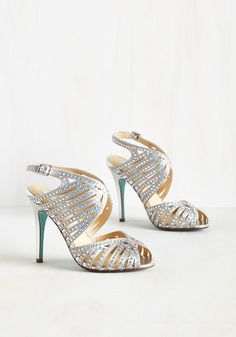 Stars shining bright above you, and your slow dance shimmers as these silver pumps by Betsey Johnson reflect each twinkle. Your sweetie, elated, sends you and your peep toes twirling - their iridescent gems and narrow cutouts as beguiling as the beauty who wears them. A 'gleam' come true, indeed.