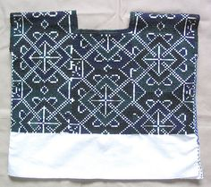 https://flic.kr/p/GmY2r   Huipil from Zinacantan   a boldly cross stitched huipil worn in Tzotzil Maya women from the town of Zinacantan near San Cristobal de las Casas Chiapas Mexico