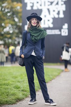 """Carolina Pimenta, photographer """"I'm wearing a Borsalino hat with a Zara scarf, jacket, top and trousers, and Acne shoes."""""""