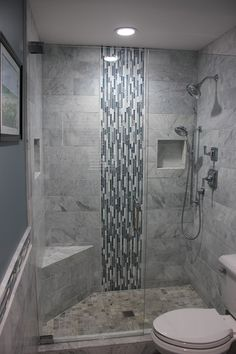Good example of a recessed product niche in tile, which keeps the shower neat and your shampoo handy