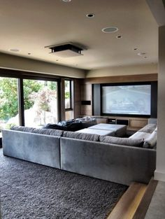 Living Room Theater open space billiard room with multiple tvs | big tvs in homes