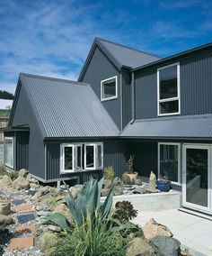corrugated cladding Light grey with charcoal trim