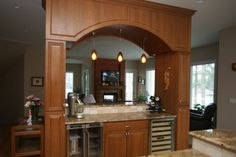 :( Weight bearing kitchen archway for sink, need cabinets a bit wider on each side, slightly wrap around countertops on right side (or not), also open archways on left and right