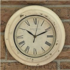 """Our Madison Wall Clock will add a touch of history to any decor, both functional and decorative. Tin clock has a distressed antique cream paint and an aged clock face. Requires a AA battery not included). Measures: 9.5"""" diameter."""