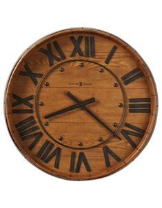 Wine Barrel Wall by Howard Miller++ This gallery wall clock features and Heirloom Oak finish and and applied metal band to resemble an authenic oak wine barrel. Wall Clock Craft, Clock Wall, Yorkshire, Wine Barrel Wall, Wine Wall, Howard Miller Wall Clock, Barris, Farmhouse Wall Clocks, Rustic Clocks