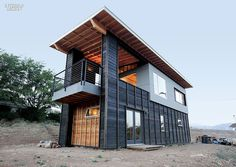 I was inspired by this architectural design and thought I'd share it with  you. Hunter Leggit of Hunter Leggit Studio guided seven student apprentices  to build a summer retreat home from discarded scrap in Lake Isabella, CA.  It's pretty cool what a few creative minds can come up with!  Image Source: InteriorDesign.net