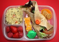 Couscous salad - Colby Jack cheese pick- Whole wheat Chicken, tomato, mustard & field greens wrap - Container with 3 M&M's - 3 Mini nutter butter cookies - Strawberries & Raspberries. Yum!    http://easylunchboxes.smugmug.com/The-Best-Lunchbox-System/Yummy-Lunch-Ideas/10136835_SnmBV2#!i=1045796264&k=34pdJ