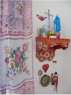 I love the colours of this shelf altar for a bathroom except mine would not be religious like this.
