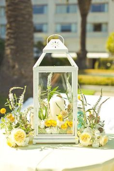We like this centerpiece too, but with a single candle in the lantern. Prefer darker lantern, but are open to white.