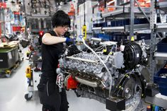A female engineer hand-builds a M157 5.5L V8 bi-turbo engine at the Mercedes-AMG engine production factory in Affalterbach, Germany. (Tim Graham/Getty Images)