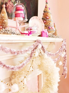In-the-Pink Mantel -- Garlands of pink tinsel and beads drape the mantel in delicate holiday splendor. Add accents of bottle-brush Christmas trees, plus anything else you can find -- as long as it's pink.
