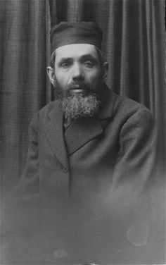 Studio portrait of a religious Polish Jewish man.  Pictured is the father of Peretz's wife (possibly Avram Szczupacki) who worked as a smith.