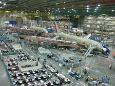 inside the boeing everett plant - the most square feet under one roof - and big enough for multiple jumbo jets