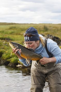 Love at first sight - My lovely wife kissing her fish of a lifetime. Would fit perfectly on a cover of any magazine in the flyfishing community. Any takers? .....;) Cheers P-A