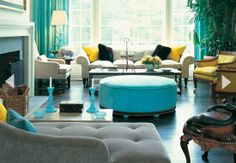 Gorgeous. I love the pops of teal and the added splash of yellow... could this be my future living room? I think yes.