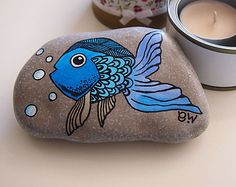 Items similar to Hand painted beach pebble paperweight stone interior decoration blue turquoise violet fish collectible children room decor gift colleague on Etsy - DIY Schule Pebble Painting, Pebble Art, Stone Painting, Stone Crafts, Rock Crafts, Caillou Roche, Art Pierre, Stone Interior, Hand Painted Rocks
