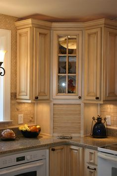 Kitchen Corner Cabinets Idea - utilize corner storage space; open shelves to the left, extended right. Door on bottom