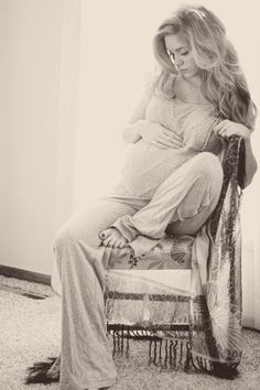 A MATERNITY PIC WHERE SHES CLOTHED WOW!!! This would be a beautiful picture to hang around the apartment