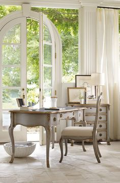The French Writing Desk in a lovely gray-blue finish with gold-leaf tipping and hardware is pure grace and elegance. Photo: Hooker Furniture.