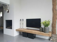 Wooden board nice as TV furniture but where does the DVD player come from? - Home Decoraiton Wooden board nice as TV furniture but where does the DVD player come from? Living Room Tv, Home And Living, Tv On Wall Ideas Living Room, Apartment Living, Sweet Home, Farmhouse Side Table, Wall Mounted Tv, Tv Cabinets, Cool Rooms