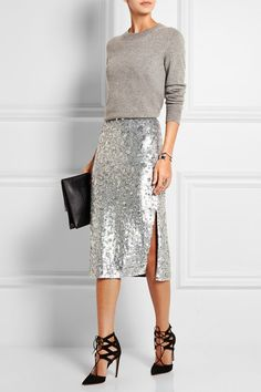 Gucci (sweater); Burberry London (skirt); Aquazzura (pumps); Proenza Schouler (clutch).