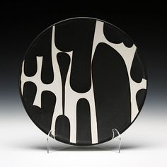 Sam Scott's Dinner Plate, porcelain with poured black glaze, from Schaller Gallery.