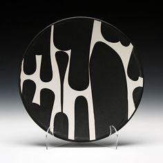 Sam Scott's Dinner Plate, porcelain with poured black glaze, from Schaller Gallery.