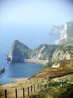 Dorset, England - love the bay surrounded by those wonderful while cliffs  (by James-Hetherington)