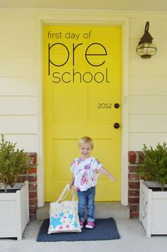 Young House Love-want to paint our front door this color. I love it. This is such a cute picture too! ----Door: Valspar's Eddie Bauer Home in Full Sun (EB1-1) color matched to Valspar's Duramax Exterior Paint in semi-gloss.