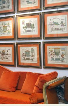 Love these french style pictures above the bright orange couch!