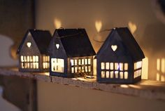 Love these little lighted house ornaments